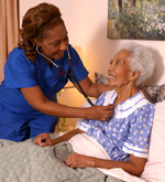 an Interim HealthCare home care nurse checks on her patient