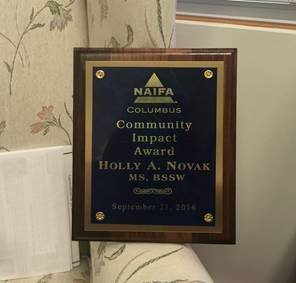 Holly A. Novak, MS, BSSW wins NAIFA Community Impact Award