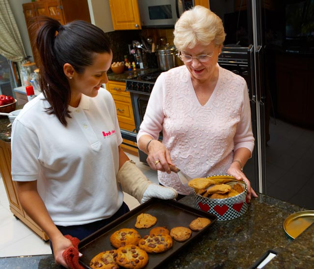 Hospice Volunteer helps her client make cookies