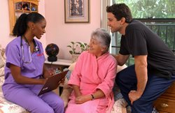An Interim HealthCare Nurse consults with a patient and her son