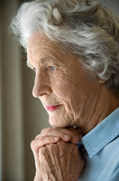cold, elderly woman looking out window