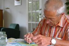 elderly man painting as a hobby