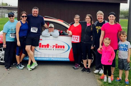 Members of the Interim Healthcare of Wausau Team and their families participating in the Chase'n Chocolate Run to benefit the Women'sCommunity on May 13, 2017.