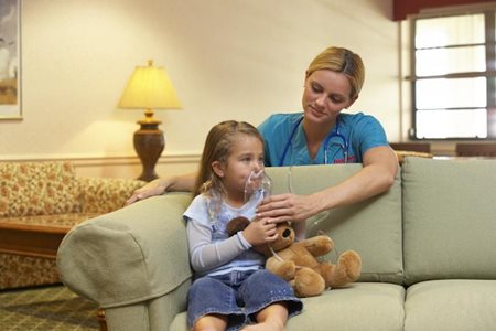 Pediatric Home Care Nurse helps child breathe