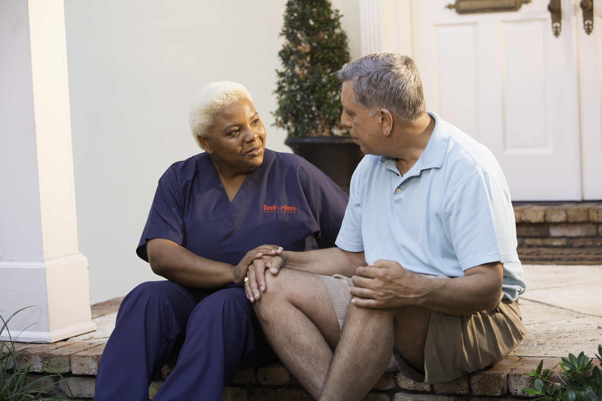 A home care professional provides care for a gentleman with Alzheimer's Disease