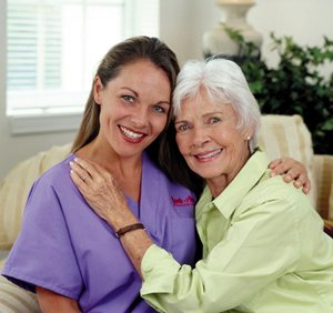 Certified Alzhiemer's Caregiver with her patient
