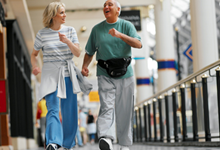 elderly couple exercise walking in mall