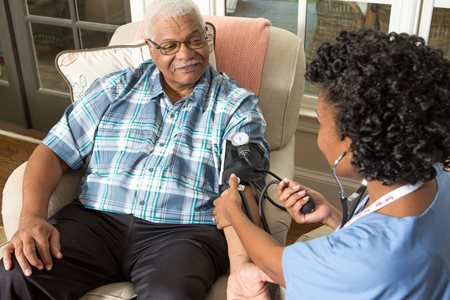 Home Care Nurse Checks for High Blood Pressure