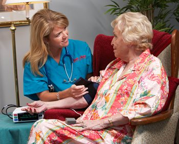 Home Care Nurse in Salisbury, NC tends to her patient