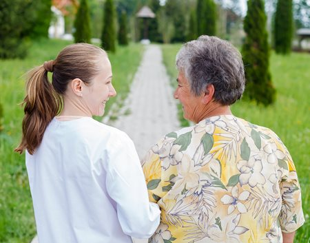 Woman discuss fall prevention with her Dr.