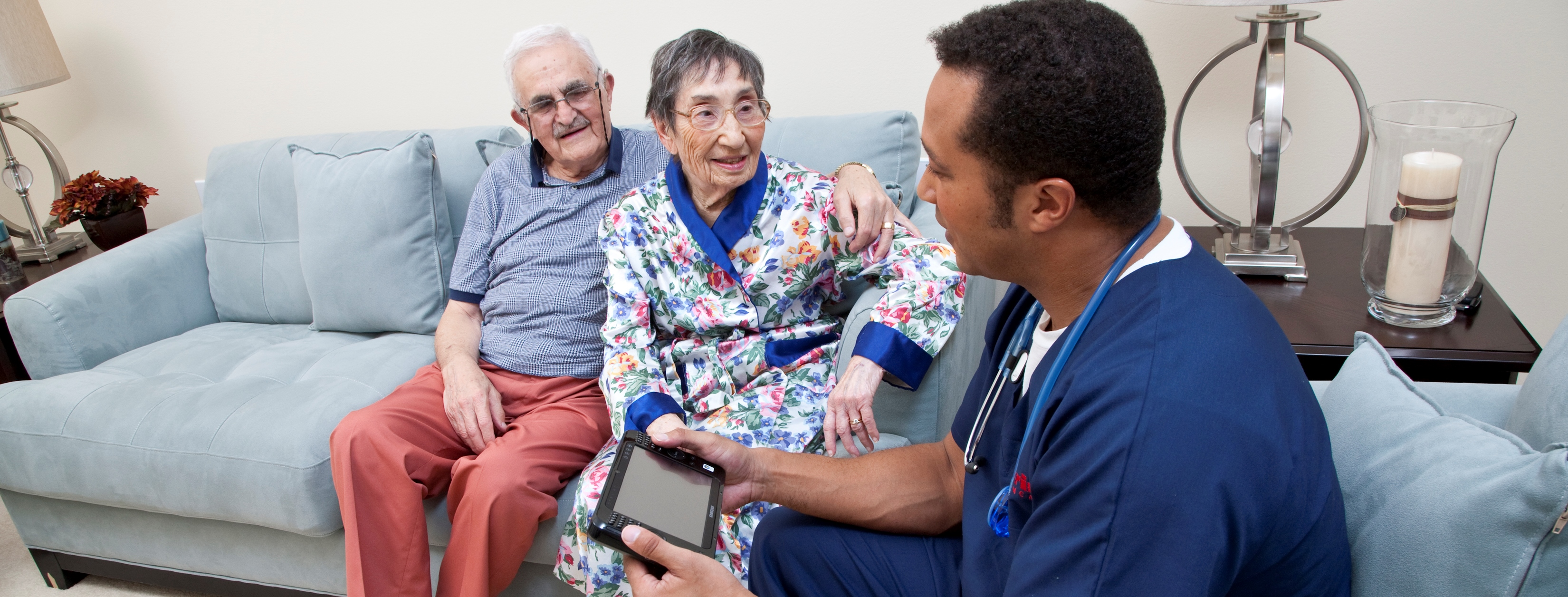 An RN from Interim HealthCare reviews a free in-home evaluation with his potential client