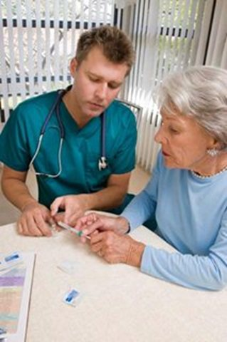RN gives woman her insulin injection- Specialized Home Care Services- Interim HealthCare
