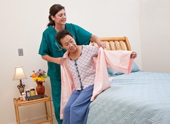 An Interim HealthCare - Home Care Nurse helps her client